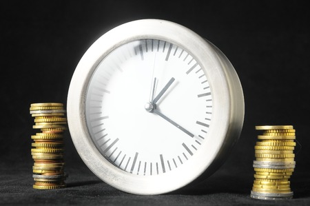 money concept: Time is Money Concept a Clock and Currency Stock Photo