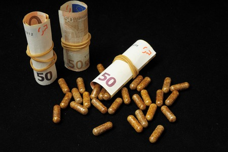 Some Pills And Money on a Black  photo