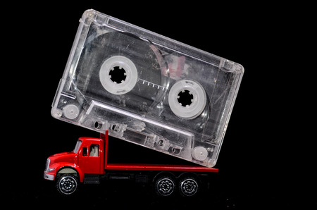 Music Concept Red Truck and Audio Music Tape on a Black  photo
