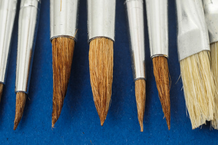 New Wooden Different Paintbrush Set Texture over a Colored Background photo