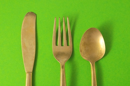 Ancient Vintage Silver Flatware on a Colored Background