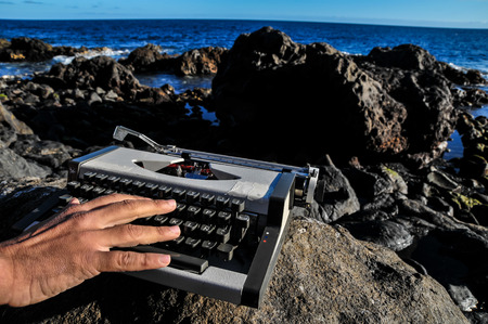 Old Ancient Vintage black and white Travel Typewriter photo
