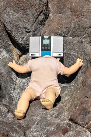 No Head Doll on the Volcanic Rocks photo