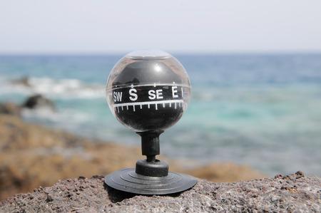 One Compass on the Rocks near the Atlantic Ocean photo