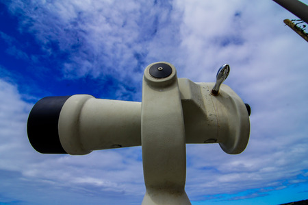 Coin Operated Telescope For Beach Observation, Blue Sky And Clouds