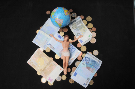 Jesus Christ and Money on a Dark Background - Religion Concept photo