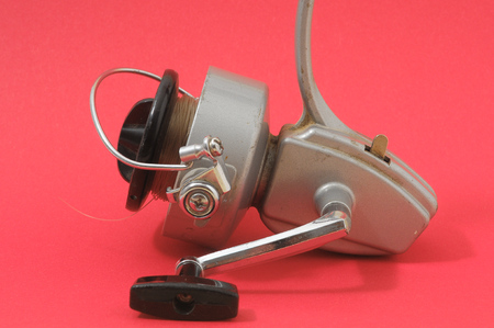 One Vintage Old Fishing Reel on a Colored Background Stock Photo - 29287808