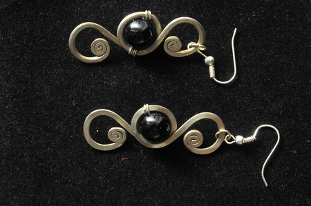 Handmade Silver Jewelry on a Black Background photo