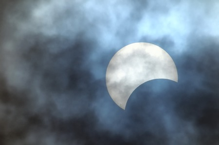 Partial Solar Eclipse on a Cloudy Day 03 11 2013 Stock Photo
