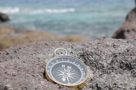 wind rose: One Compass on the Rocks near the Atlantic Ocean Stock Photo