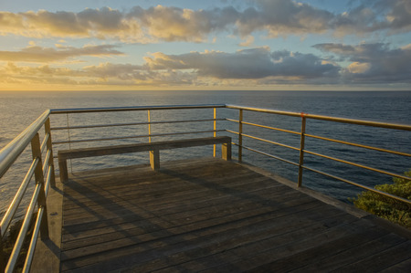 HDR Picture Sunrise on a Pier over Atlantic Ocean in Tenerife Canary Islands Spain photo