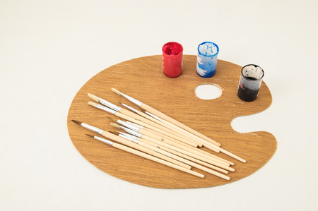 New Painting Wooden Palette on a White Background photo