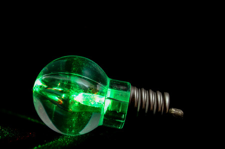 Photo of an Illuminated Light Bulb on Black Background photo