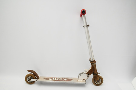 Metal scooter for child on white background photo
