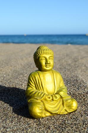 One Ancient Buddha Statue Near The Ocean photo
