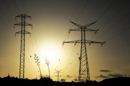 Electric Power Line Pylon over a colored Sunset photo