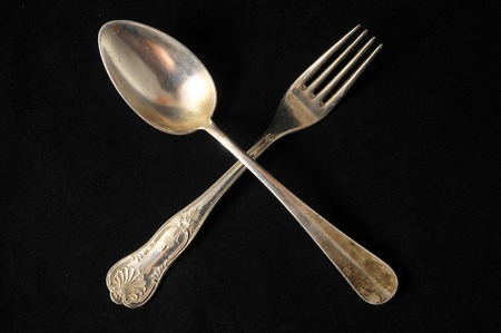 grunge flatware: Ancient Vintage Silver Flatware on a Black Background