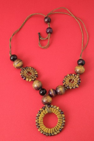 Handmade Wood Collar Necklace on a Colored Background photo