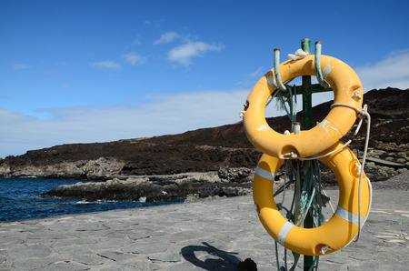 Yellow Life Saver on a Pier in Canary Islands el Hierro Spain Stock Photo