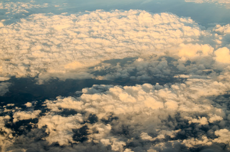 Flying Above the Clouds View from an Airplane photo