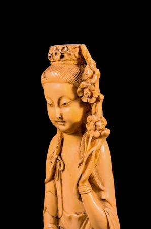 Oriental Buddist Statue Isolated on a Black Background photo