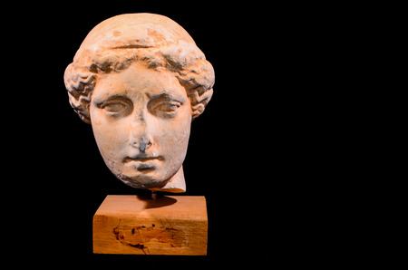 Head of the Ancient Greek Statue Isolated on a Black Background photo