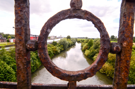 Green River Bridge View Through Rusty Railing photo