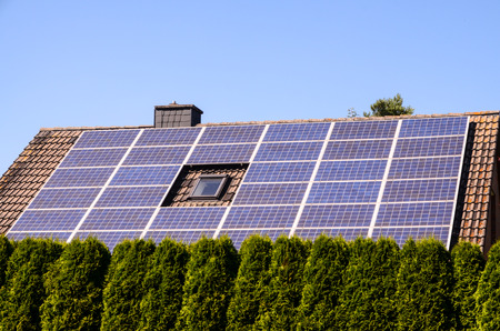 Green Renewable Energy with Photovoltaic Panels on the Roof. photo