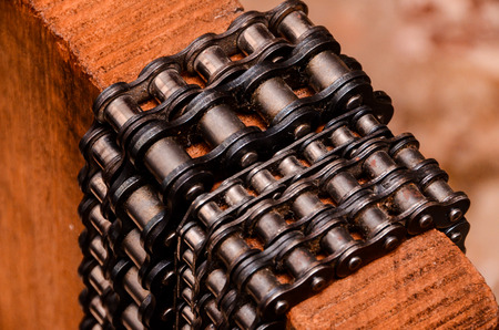Part of a Used Automotive Gear Chain n a Wooden Background photo