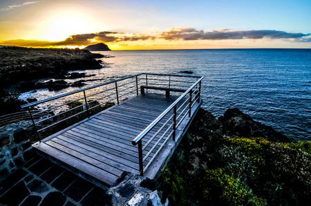 Sunrise on a Pier over Atlantic Ocean in Tenerife Canary Islands Spain photo