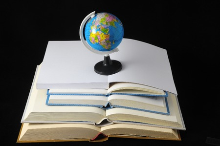 Empty Classic Books and a globe Isolated over a Black Background photo