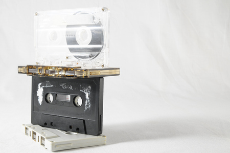disuse: Used Music cassettes over a White Background