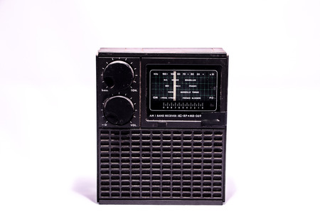 Old Retro Vintage 70s Radio on a White Background photo