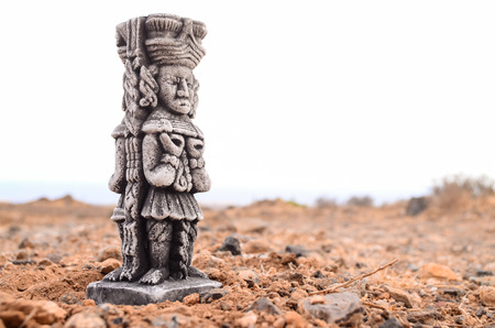 Ancient Maya Statue on the Rocks Desert photo