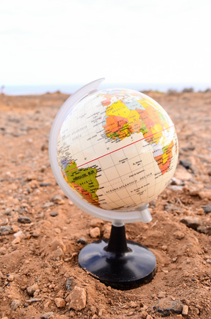 Globe Planet Earth in the Rock Desert photo