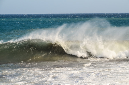 Big Blue Wave Breaks in the Atlantic Ocean photo
