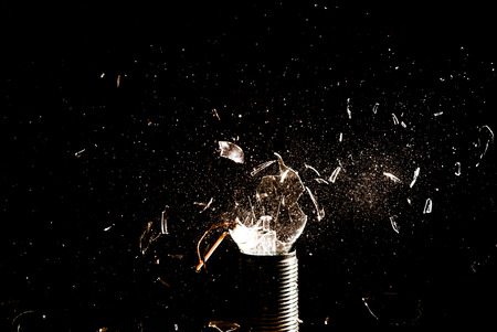 lampe: Broken Incandescent Light Bulb on a Black Background Stock Photo