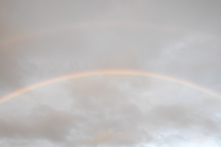 Colored Rainbow over a Cloudy Sky in Tenrife Canary Islands photo