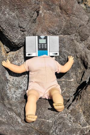 No Head Doll on the Volcanic Rocks photo
