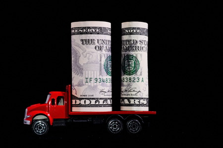 Transportation of Money for the Red Toy Truck Business Concept photo