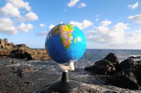 Ancient Vintage Globes Planet Earth near the Atlantic Ocean photo