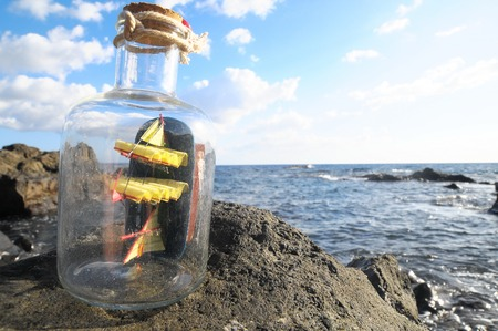 Ancient Spanish Sailing Boat in a Bottle near the Ocean photo