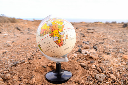 climate change: Globe Planet Earth in the Rock Desert
