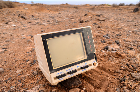 Broken Gray Television Abandoned in the Desert photo