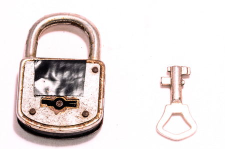 Old Antique Vintage Padlock on a White  photo