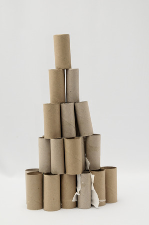 Empty Toilet Rolls Stack Up On a Black Background photo