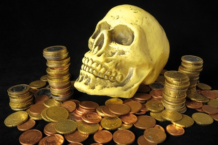Death and Money Concept Skull and Currency over a Black Background photo