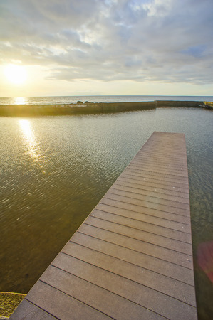 naivasha: Sunrise on a Pier over Atlantic Ocean in Tenerife Canary Islands Spain
