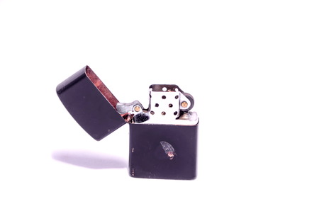 Vintage Zippo Style Lighter On a White Background photo
