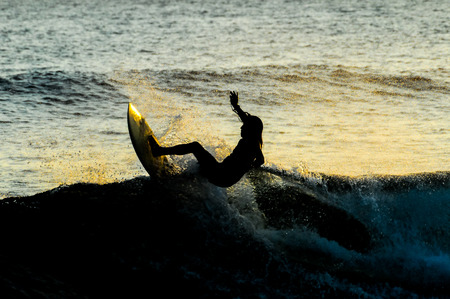 Silhouette Surfer at Sunset in Tenerife Canary Island Spain photo
